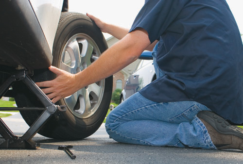 Changing a tire and teaching a son kindspring org