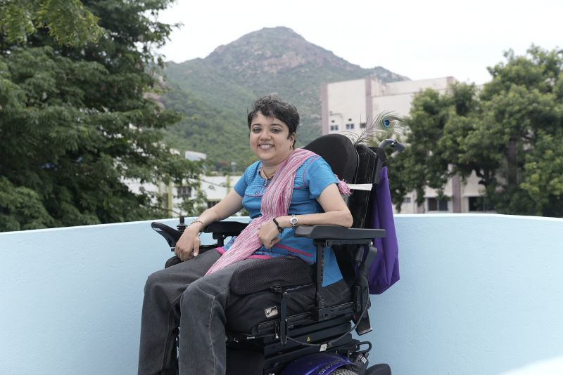 Preethi at Soulfree Inspire rehabilitation facility, with sacred mountain Arunachala in the background
