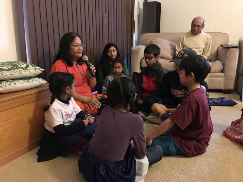Aunty introducing the children to meditation with the ringing bowl